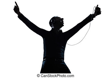 silhouette man portrait happy listening to music - one...
