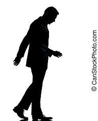 one business man walking looking down silhouette