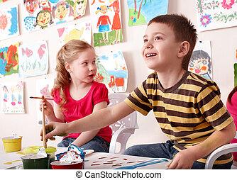 Children painting in art class. Child development.