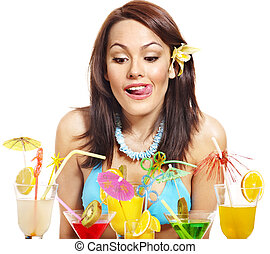 Girl in bikini on beach drinking cocktail. - Young woman in...