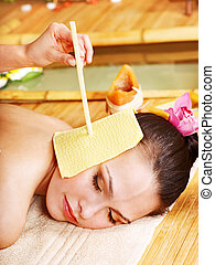 Woman getting massage with ear candle . - Woman getting...