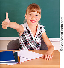 Schoolchild in classroom near blackboard. - Happy...