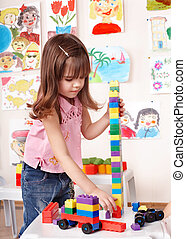 Child playing construction set in play room - Little girl...