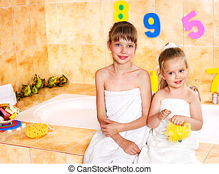 Children washing in bubble bath . - Little girl washing in...