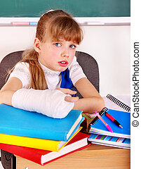 Disabled child with broken arm. - Disabled child with broken...