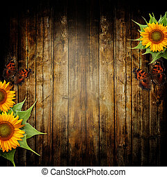 Wooden background with butterfly and sunflower for greeting...
