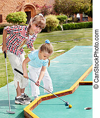 Children playing golf. - Children playing golf outdoor.