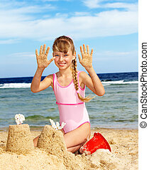 Child playing on beach - Little girl playing on beach