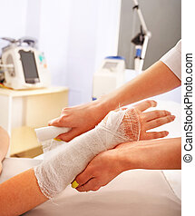 Bandaging patient in hospital. - Bandaging hand patient in...