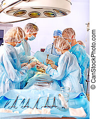 Surgeon at work in operating room. - Group people surgeon...