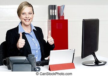 Senior businesswoman gesturing thumbs up