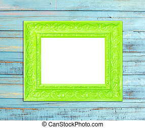 Green Vintage picture frame on blue wood background - Green...