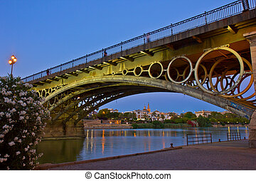 Triana Bridge at night, Seville, Spain - Triana Bridge and...
