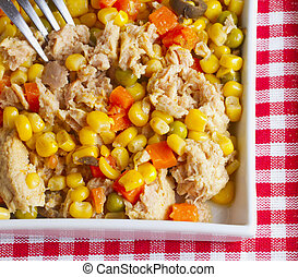 Salad - A salad with corn, carrots and tuna in a white...