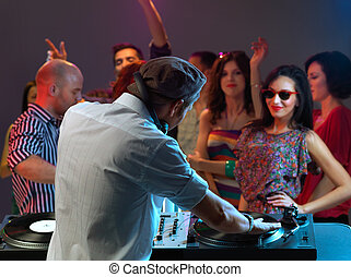 women flirting with dj in night club - dj entertaining the...