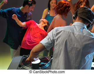 dj playing music in night club - dj entertaining the happy,...