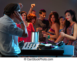 woman flirting with dj in night club - happy, young crowd...