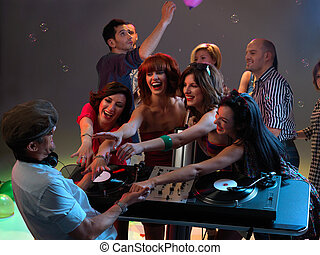 women flirting with dj in night club - sexy, young women...