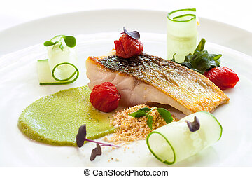 Grilled seabass with cherry tomatoes and avocado. - Macro...