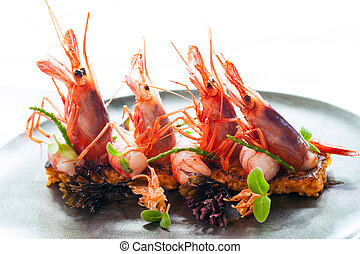 King prawns with crisp seafood rice. - Macro close up of...