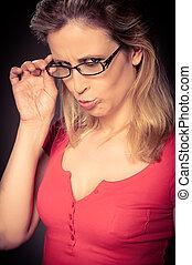 Young teacher showing a wierd expression - Young teacher...