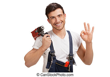 Portrait of happy young handyman with tool - Portrait of...