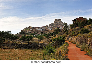 Morella in Spain. Landscape with rural road with castle and town as background.
