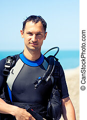 young man in a diving suit - Portrait of a handsome young...
