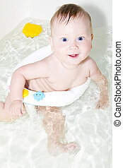 blue-eyed Baby swimming in the bath - Blue-eyed Baby...