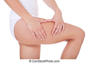 Female person checks her skin on cellulite All on white...