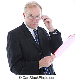 Businessman with assessing look - Middle-aged businessman...