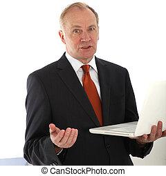 Persuasive businessman holding laptop - Persuasive...