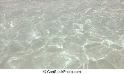 beautiful shore beach with ripple and wavy water reflection...