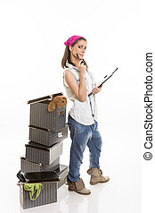 Organized packing - Casual dressed woman keeping track of...