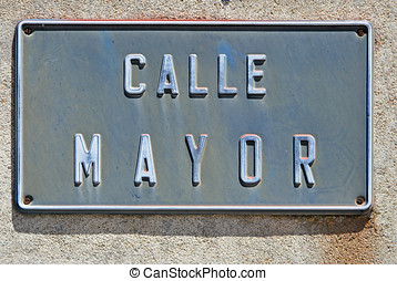 Calle mayor - Main Street Street name plate attached with...