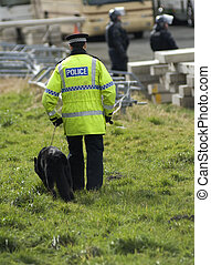 Uk Police Officer - Uk police officers with a police dog at...