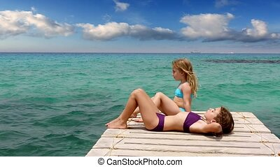 beautiful girls tan in ibiza beach - beautiful girls tanning...