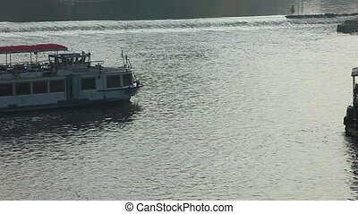 Pleasure boats move on vltava river time lapse - Pleasure...