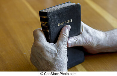 holding the bible over table