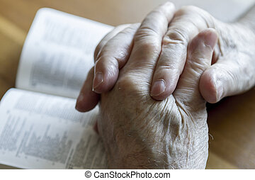 Praying Old Hands - weathered old mans hands clasped in...