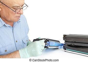 Man repairing toner cartridge
