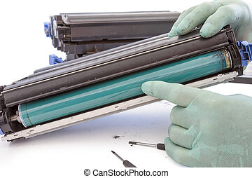 hands repairing toner cartridge - repairer of service he...