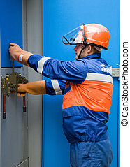 caucasian electrician working on a panel