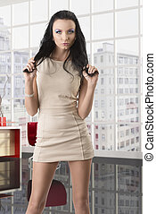pretty brunette with short dress takes her hair - beautiful...