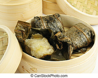 Sticky Rice - Steamed Chinese rice dumplings wrapped in...