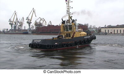 Tug-boat floats on the river