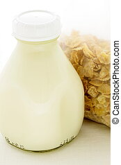 corn flakes cereal pack with pint glass milk bottle