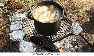 Russian fish soup on fire 1