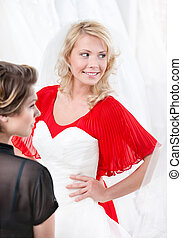 Bride puts the wedding gown to hesitating whether she should...