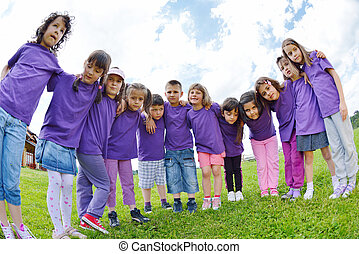 happy kids group  have fun in nature